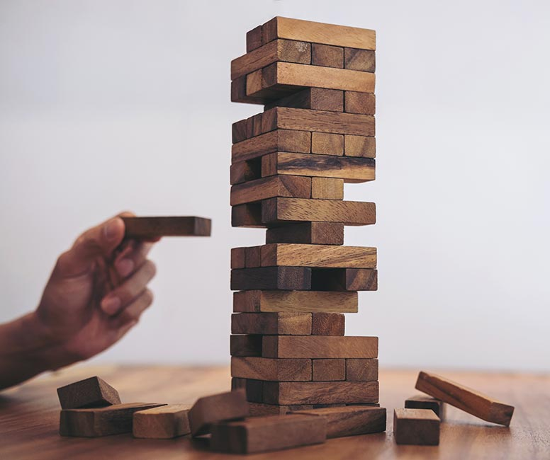 Jenga game signifying how product scraping can undermine your business