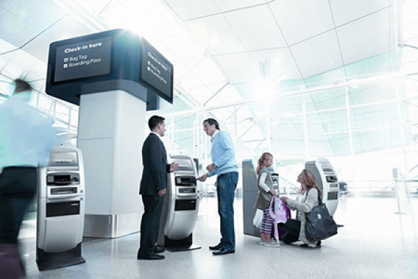man at check-in desk at airport following a good website experience with Qantas