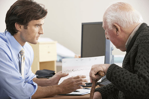 old man and advisor discussing insurance